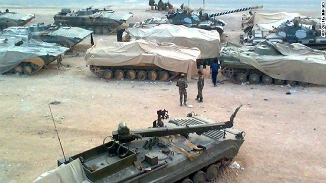 A picture released by the Local Coordination Committees in Syria shows troops taking position in Homs on January 19, 2012 .