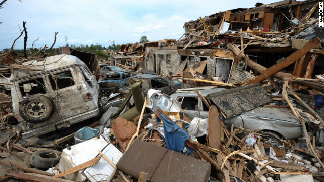 Damaged buildings and cars litter Tuscaloosa, Alabama, following a deadly tornado in 2011.