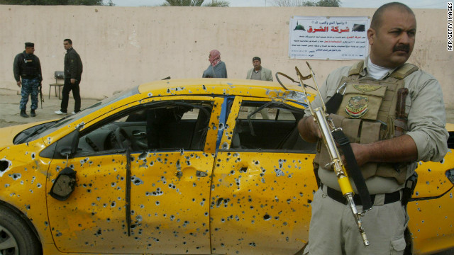 Iraqi security forces inspect the scene of a motorcycle bomb blast in the city of Kirkuk on Thursday.