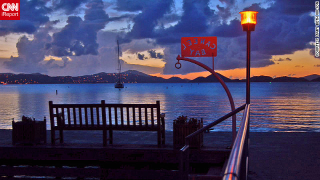 "Mary Beth Wilson captured this picturesque view of St. Thomas at sunset from Caneel Bay Resort on St. John. ""We feel at home there."""