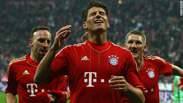 Mario Gomez celebrates scoring the opening goal for Bayern Munich in a 2-0 win against Wolfsburg