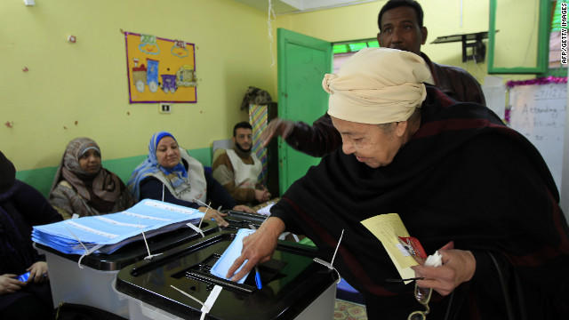 An Egyptian woman casts her ballot at a polling station in Cairo's Zamalek neighbourhood. 
