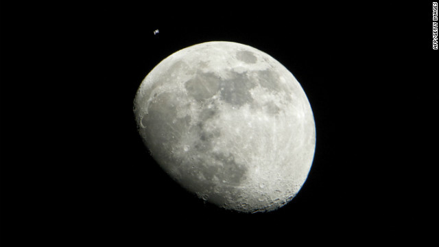 A NASA photograph released this month shows the moon and the international space station.