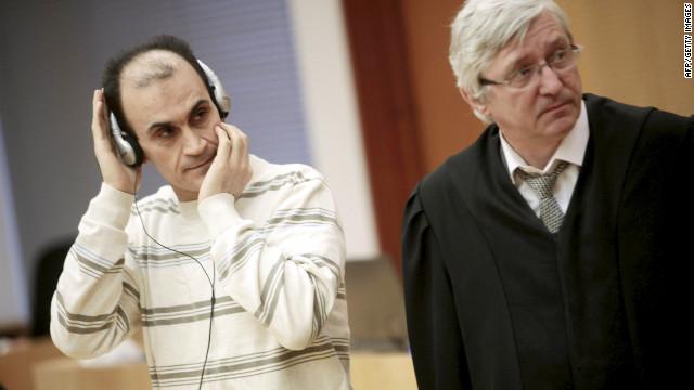 Defendant Shawan Sadek Saeed Bujak Bujak, left, stands next to his lawyer, Arvid Sjoedin, on Monday during his sentencing in Oslo, Norway.