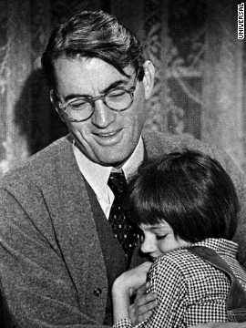 Gregory Peck and Mary Badham as Atticus and Scout.