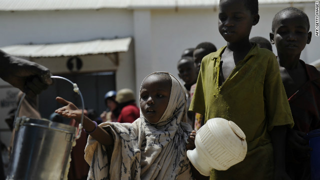 Displaced Somali children queue as they wait for food-aid rations in the capital, Mogadishu, on January 19, 2012.
