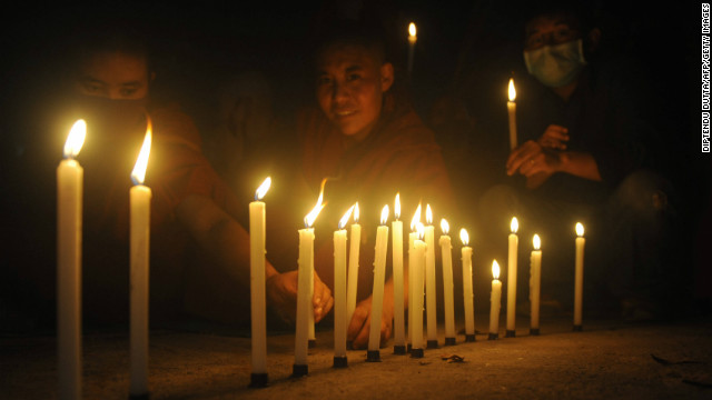 Buddhist people attend a candle vigil of the Tibetan Community in memory of self immolations in Tibet during the eighth day of the Kalachakra Festival in Bodhgaya, India, on January 8, 2012.
