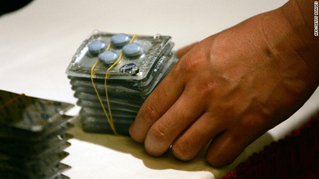 A police officer shows fake Viagra that was seized in raids in Beijing, China.