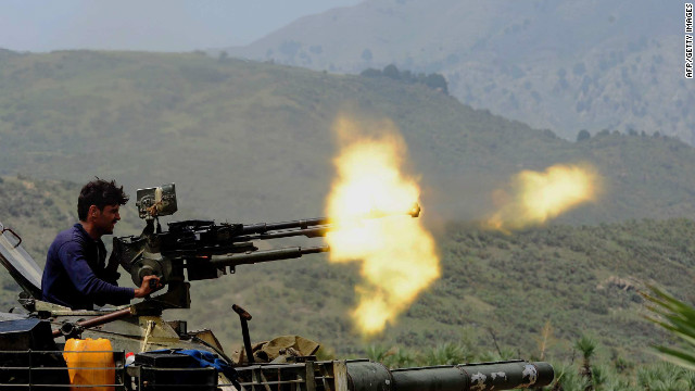 A Pakistani soldier fires a machine gun in Kurram, Pakistan on July 10, 2011.