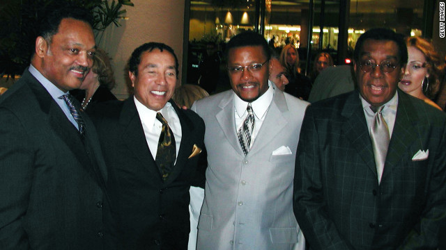 Shown here with the Rev. Jesse Jackson, from left, singer Smokey Robinson and TV personality Judge Greg Mathis, the &quot;Soul Train&quot; creator attended an event in December 2001.