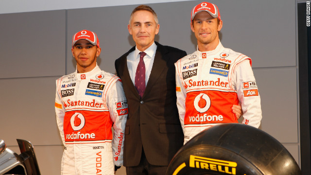 Hamilton and Button are pictured here with team principal Martin Whitmarsh, who vowed that McLaren will challenge the dominance of two-time defending world champions Red Bull.