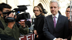 Ecuador says U.K. have threatened to storm its' Embassy to get Assange 120201061356-assange-court-story-body