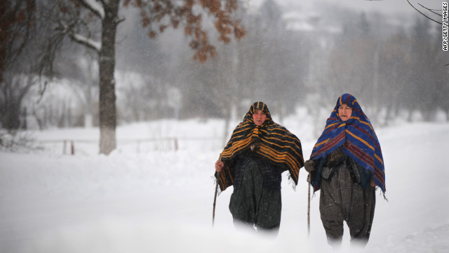 Bulgarian women walk through heavy snow January 28 in Rakovski.