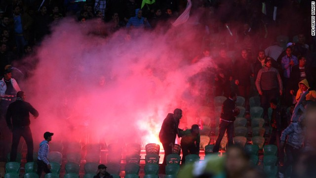 Flares are thrown in the stadium during clashes that erupted after the match between Al-Ahly and Al-Masry in Port Said.