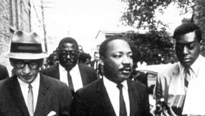Don Cornelius, seen to the right of Martin Luther King Jr., didn\'t preach protest on Soul Train. But the show\'s impact was political, some say.