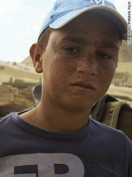 Wally Hosni, 15, who works at the Pyramids giving horse rides to tourists, was thrust into the revolution when he was persuaded to join a group of men riding horses and camels into Tahrir Square on the infamous <a href='http://edition.cnn.com/2011/WORLD/meast/02/02/egypt.protests.scene/index.html'>Day of the Camel</a>. He was almost killed as a result. His story is used in the film to illustrate the manipulation of the poor by those in power, says director Petr Lom.
