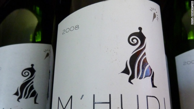 M'hudi is an organic vineyard. They use no artificial pesticides and allow for natural growth outside of the vine.