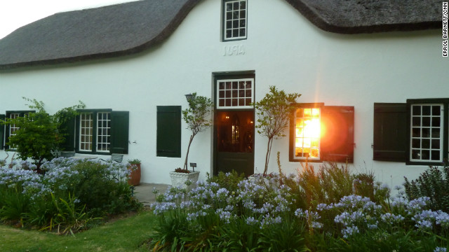 The sun sets through the house of Ken Forrester, a local wine maker.