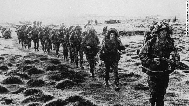 A line of British soldiers in camouflage advancing during the 1982 Falklands conflict.