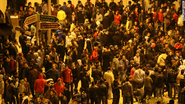 Egyptians gather outside the train station in Cairo as they wait for the arrival of people wounded at the match in Port Said.