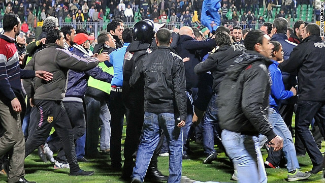 Fans storm on to the pitch during riots that erupted after the football match between Al-Masry and Al-Ahly.