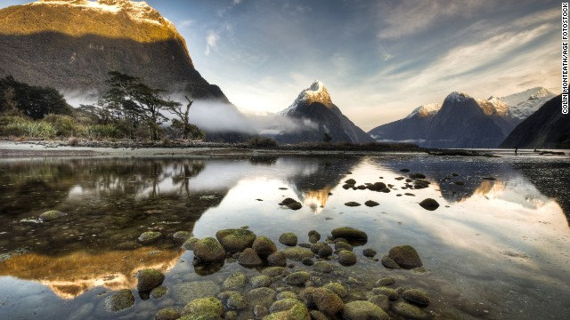 Dawn breaks during winter at Mitre Peak in Milford Sound, the most famous of the 15 fjords in Fiordland National Park.