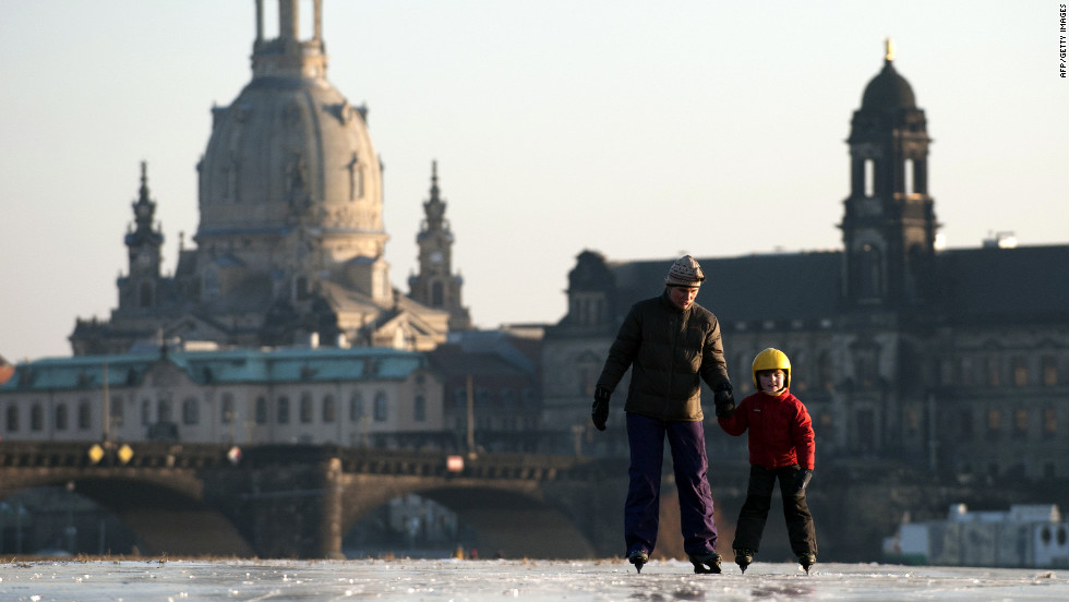 A young boy and his mother skate on the partly frozen river Elbe as the skyline of the eastern German city of Dresden is silhouetted in the background on Thursday. A cold snap kept Europe in its icy grip, pushing the death toll past 150 as countries from Italy to Ukraine struggled to cope with temperatures that reached record lows in some places.