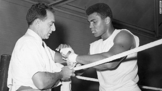 <br/>Angelo Dundee helped a young Cassius Clay transform himself into the world heavyweight champion. Here he tapes the renamed Muhammad Ali's hands at a training session ahead of a 1966 bout with British champion Henry Cooper.