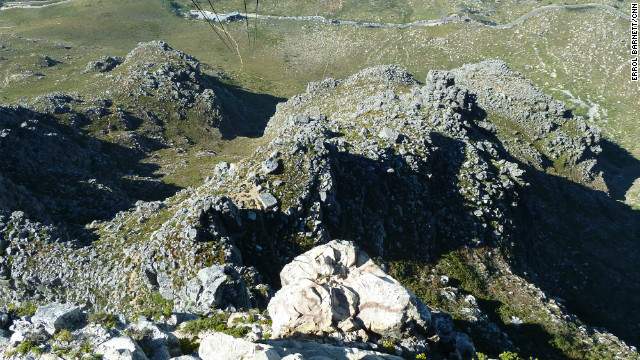 "A 1,000-meter drop from the top of Table Mountain to the Cape Town ""bowl"" below."