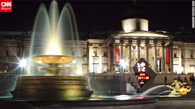 William Hoki took this photo of the National Gallery, including the 2012 Olympic countdown clock in the frame. &quot;The fountains at Trafalgar Square were recently restored with LED lights that gradually change colors. It's an amazing spectacle at night.&quot;