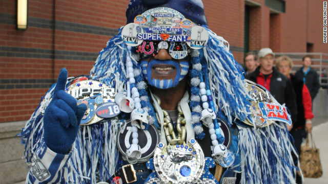 An avid fan displays the memorabilia from past and present Super Bowl contests ahead of the game in Indianapolis.