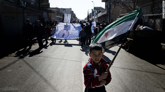 A young boy carries the Syrian rebel-adopted flag during an anti-regime demonstration Friday in al-Qsair.