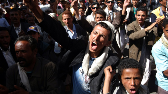 Yemeni anti-government protesters shout slogans during a rally in Sanaa on Sunday.