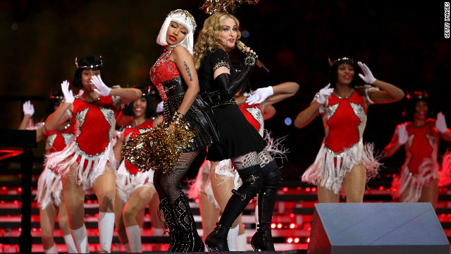 "Nicki Minaj and M.I.A. (not pictured) join Madonna on stage dressed as cheerleaders. The pair are featured on ""Give Me All Your Luvin,"" the first single on Madonna's forthcoming ""M.D.N.A."" It's due out in March."