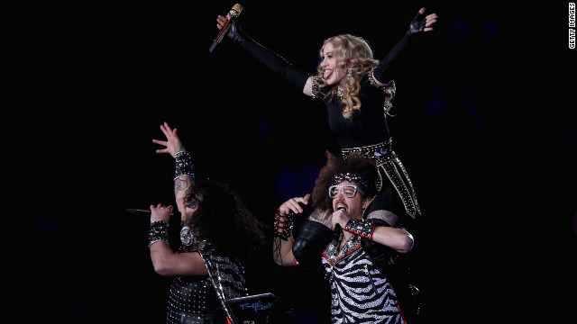 Madonna performs with Redfoo and Sky Blu of LMFAO, the twosome behind the chart-topping single &quot;Sexy and I Know It.&quot;