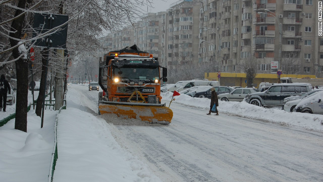 Snow paralyzes traffic in Bucharest, Romania, on Monday.