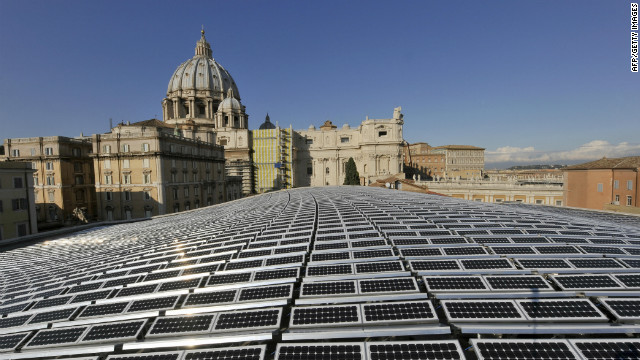 Solar panels shimmer in the sunlight in front of St Peter's Basilica in the Vatican City. One thousand photovoltaic panels cover the roof of the Paul VI Audience Hall that generate enough electricity to meet all heating, lighting and cooling requirements of the 6,300 seat venue.