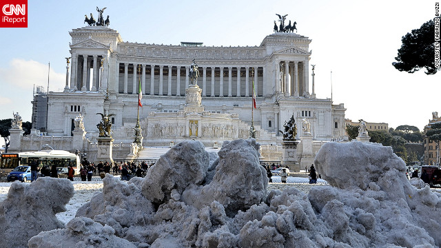 iReporter Fabrizio Buzzi sent this shot taken in central Rome on Saturday. &quot;People go out to enjoy the experience as snow is a rare sight in Rome,&quot; says Buzzi.