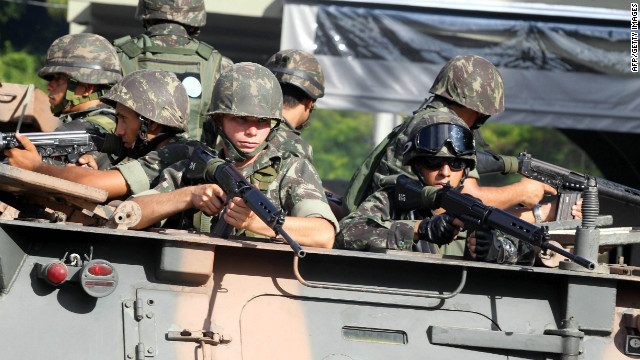 Brazilian soldiers patrol the streets of Salvador on February 5, 2012, following a strike by military police