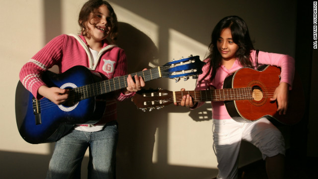 Guitar students in a classroom performance
