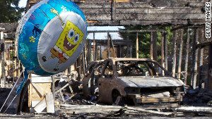 Balloons have been left in front of the charred home of Josh Powell on Tuesday near Graham, Washington..