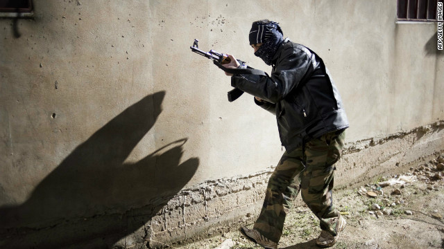 A member of the Free Syrian Army takes position in Al-Qsair, southwest of the flashpoint city Homs, on January 27.
