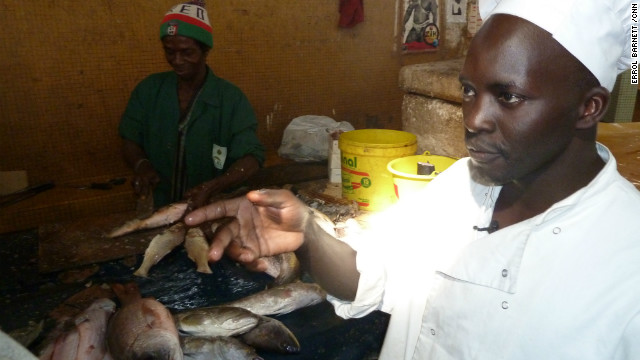 Chef Ishmail N'Dour purchases fish, a key component of &quot;Thiebou Jen,&quot; the national dish. 
