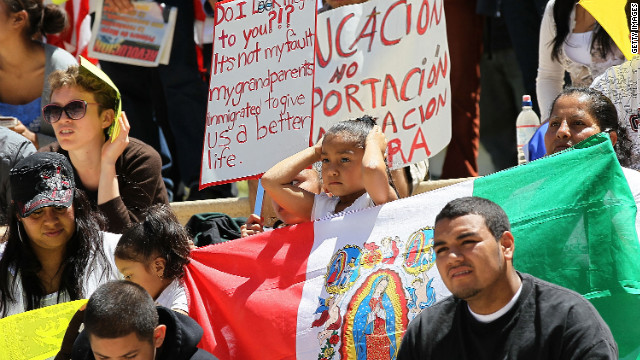 Activists in California protest Arizona's immigration law. Charles Garcia says immigration is kryptonite for both parties.