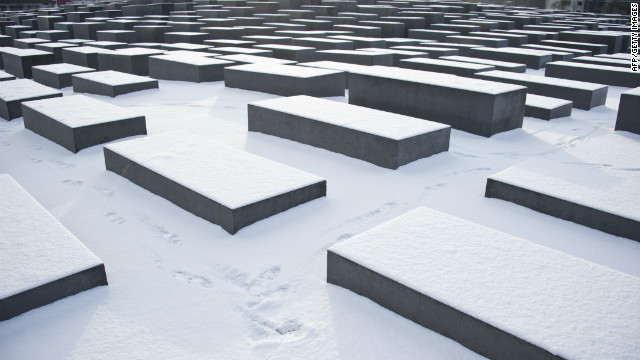 A man walks past concrete steles of the Monument for the Murdered Jews of Europe after fresh snowfall on February 9, 2012 in Berlin. 