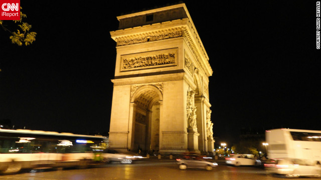 "David Hetzler snapped this shot of the Arc de Triomphe while taking an evening stroll during his time in the city. ""The beauty of it at night is impressive."""