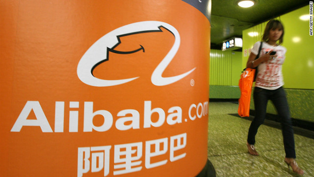 A pedestrian walks past Alibaba.com advertising in Hong Kong.