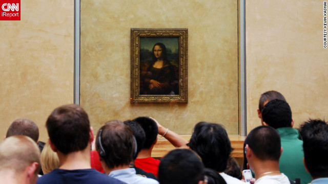 "Kevin Kasmai snapped this photo of curious onlookers taking in the ""beauty and mystery"" of the famous Mona Lisa painting at the Louvre."