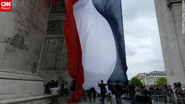 Carolyn Breathed snapped this shot of the French military raising the flag the day before Bastille Day. &quot;It was really thrilling to finally see the French flag flying proudly under the Arc de Triomphe.&quot;