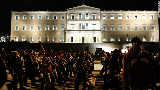 Protesters march against austerity cuts Thursday in front of the Greek Parliament in Athens.